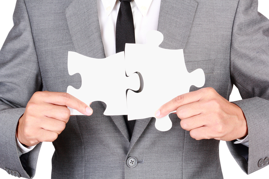Businessman Holding Mismatch Jigsaw